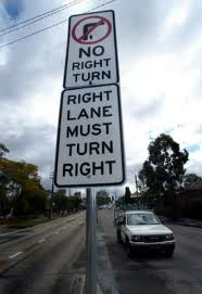 Contradictory right turn sign
